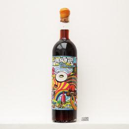 bouteille de Love is Rivesaltes 2006, un vin AOP du vigneron Carlos Badia de La Cave aux fioles dans le Roussillon et distribué par l'agence L'envin grossite en vins bio et nature sur paris ile de france loiret export